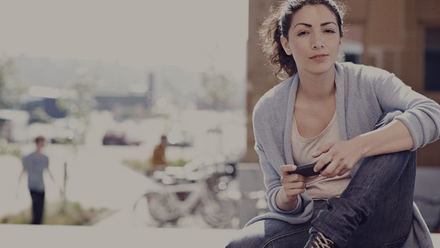 casual woman with phone outside 3 small overlay