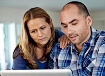 Couple looking at computer full